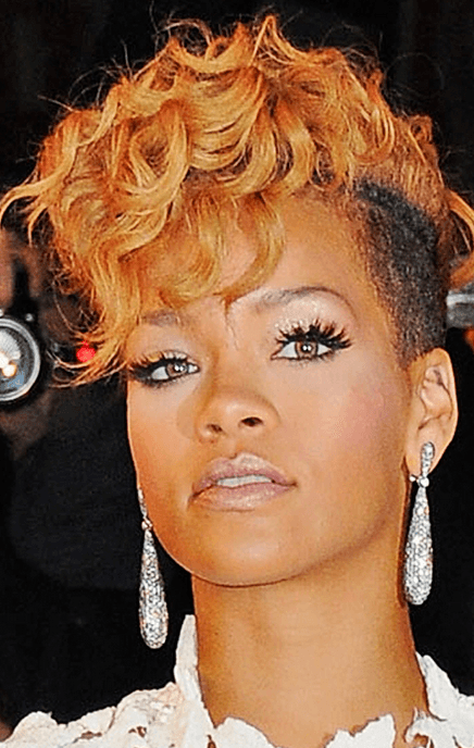 Photo_of_Rihanna_with_her_extreme_short_haircut_with_long_curly_top_and_bangs_in_orange_red_hair